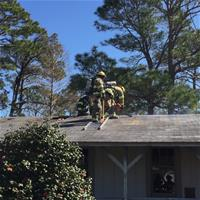 Firefighter on top of roof