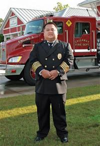 Fire Chief posing in front of Fire Department vehicle