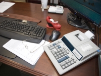 Image of office desk with computer and calculator